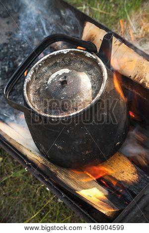 Old Black Boiling Teapot On Bonfire