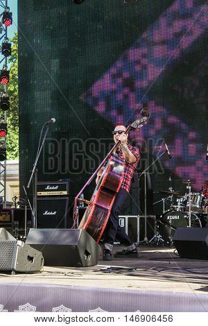 St. Petersburg, Russia - 12 August, Musician with contrabass,12 August, 2016. Pop and rock musicians on Harley Davidson festival in St. Petersburg.