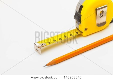 Measure Tape With Pencil And Gloves Near It