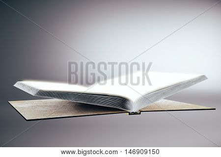 Empty open hardcover book on grey background. Education concept. Mock up 3D Rendering