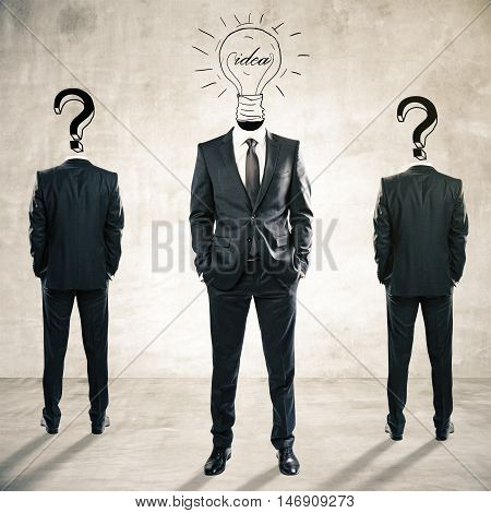 Two question mark headed businessmen behind light bulb headed man on textured concrete background. Idea and leadership concept