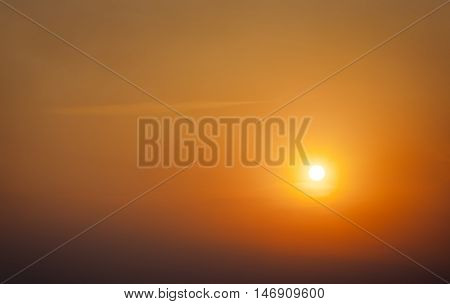 Bright big sun on the sunset sky.