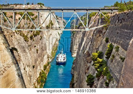 Ship cross The Corinth Canal that connects the Gulf of Corinth with the Saronic Gulf in the Aegean Sea.