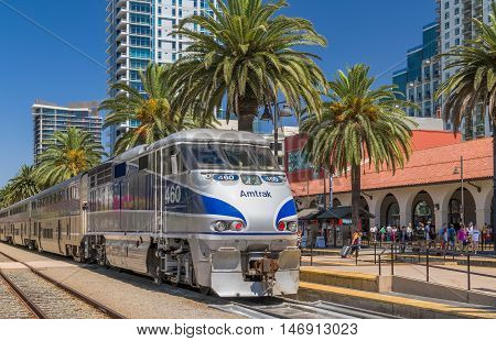 SAN DIEGO CA/USA - SEPTEMBER 9 2016: Amtrak train arriving at Santa Fe Depot in downtown San Diego.
