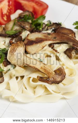 porcino mushrooms and tagliatelle on a white plate