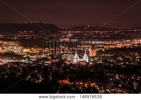 Night aerial view in San Diego city with illuminated buildings and mormon temple church