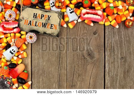 Happy Halloween Tag With Candy Top Corner Border Against A Rustic Wood Background