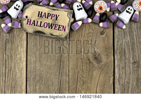 Happy Halloween Tag With Candy Top Border Against An Aged Wood Background