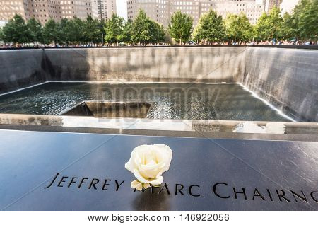 New York USA - SEP 3 2016. View of Flower left at the National September 11 9/11 Memorial at the World Trade Center, Ground Zero site.The memorial was dedicated on the 10th anniversary of the Sept. 11, 2001 attacks.