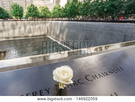New York USA - SEP 3 2016. View of Flower left at the National September 11 9/11 Memorial at the World Trade Center Ground Zero site. The memorial was dedicated on the 10th anniversary of the Sept. 11, 2001 attacks.