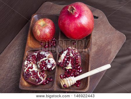 Rosh Ha Shana concept with red pomegranates