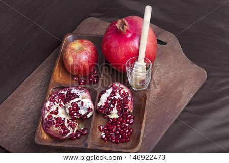 Pomegranates And Apple On Wood