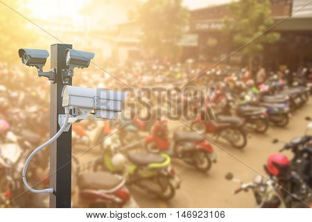 CCTV camera operating in car or motorcycle parking , Concept Security in condo, apartment or supermarket car park