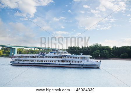 Passenger ship goes on the Volga River in the summer navigation, Russia