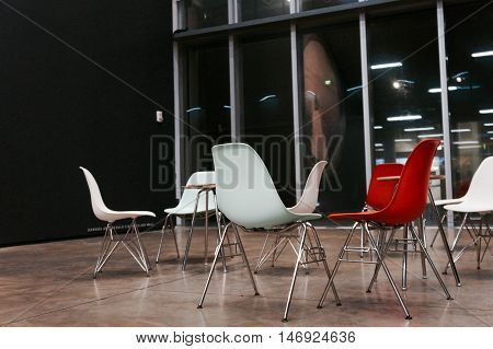 Artsy cool looking chairs inside of a modern looking space