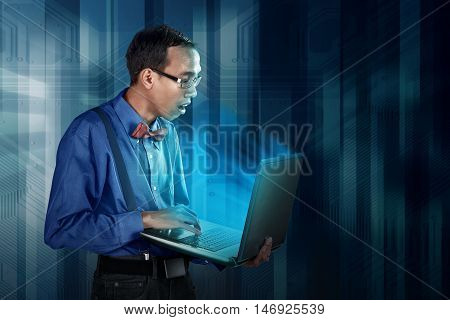 Nerdy Man Using Laptop