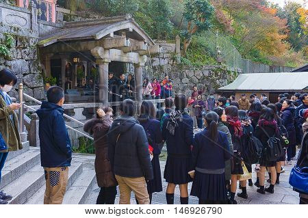 Kyoto Japan - December 4 2015: unidentified People Waiting for Water in Kiyomizu-dera Shrine Temple . can catch and drink the water which is believed to have wish-granting powers.