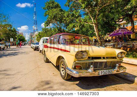 CIEGO DE AVILA, CUBA - SEPTEMBER 5, 2015: Classic vintage American cars in Downtown of Ciego de Avila. Located in the central part of Cuba.