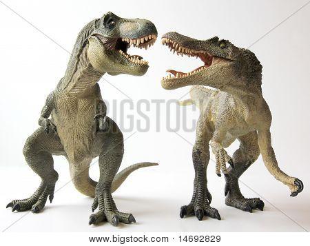 A Tyrannosaurus Battles a Spinosaurus