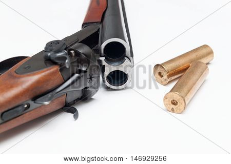 Part of shotgun and ammunition on white background