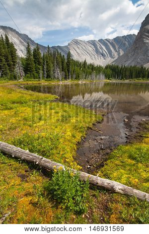 Landscape of one of the four Picklejar Lakes in surrounded by the Rocky Mountains in Kananaskis Alberta.