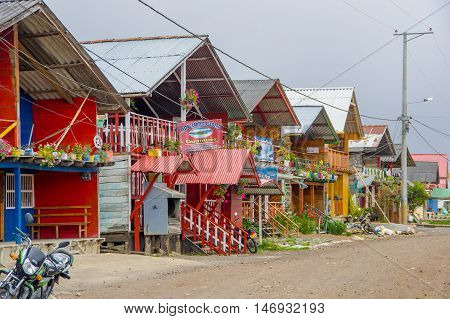 PASTO, COLOMBIA - JULY 3, 2016: some colorfull shops located on the shore of la cocha lake.