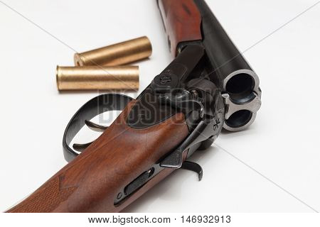 Part of gun with two bullet in white background