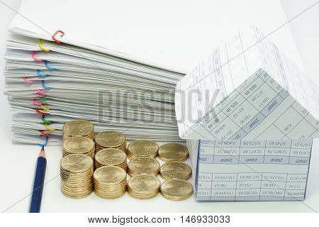 Pencil And Step Pile Of Gold Coins With House