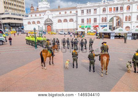 PASTO, COLOMBIA - JULY 3, 2016: the national police of colombia preparing an exibithion with police dogs and horses.