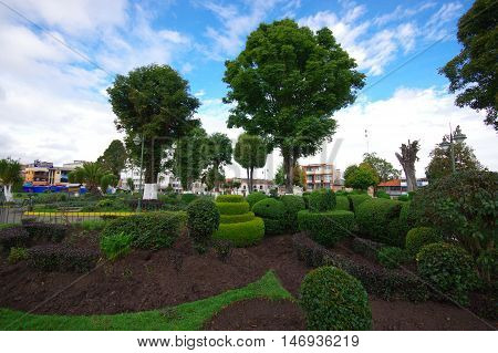 TULCAN, ECUADOR - JULY 3, 2016: topiary sculptures in one of the parks of the city.