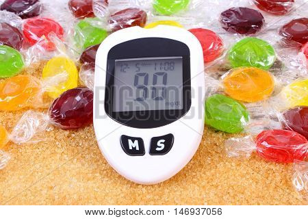Glucometer, Candies And Granulated Brown Cane Sugar, Concept Of Diabetes