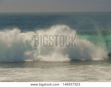 Giant waves crash on the beach at The Wedge in Newport Beach, CA during a large swell.