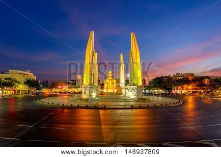 Moment of Democracy monument at twilight time it's not car on the roads (Bangkok Thailand)