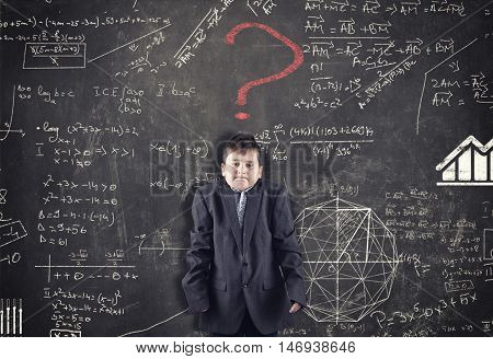 Confused kid and blackboard with formula and red question mark asking for solution