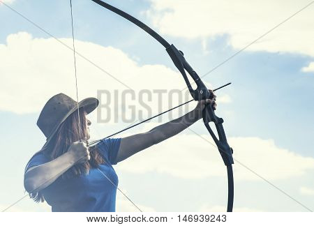 Archery woman bends bow archer target narrow .