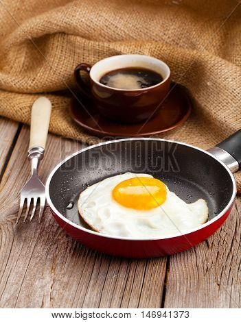 fresh fried eggs on a wooden background