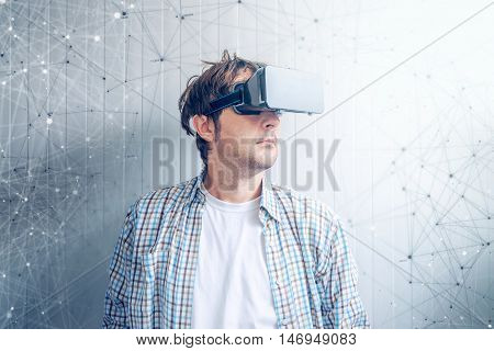 Guy with VR goggles watching 3d multimedia content