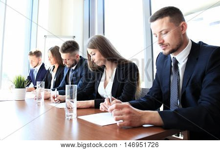 Image of row of business people working at seminar