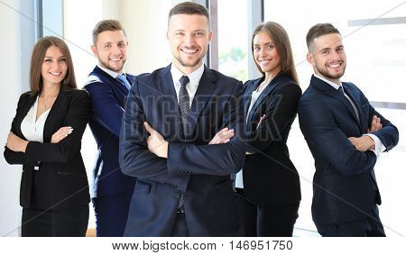 Portrait of happy business partners looking at camera