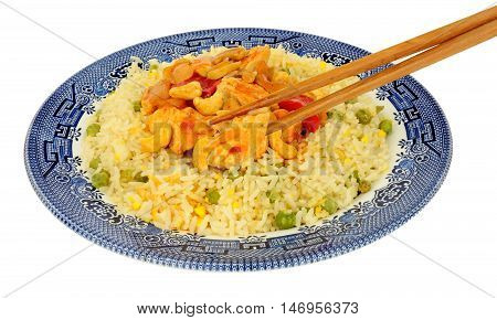 Chinese Kung Po chicken meal isolated on a white background