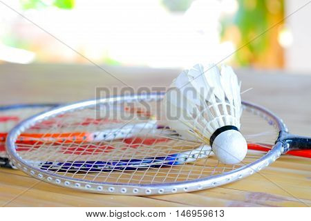 shuttlecock and badminton racket on the table