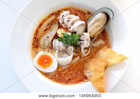 Tom Yum sea food noodle on white table (Thai cuisine)