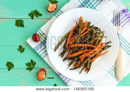 Baked green beans and carrots - vegan diets. The top view