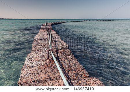 Stone breakwater in the Red sea near Hurhgada