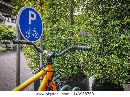Parking lot for bicycles. Bike parking space. Sign of parking space.