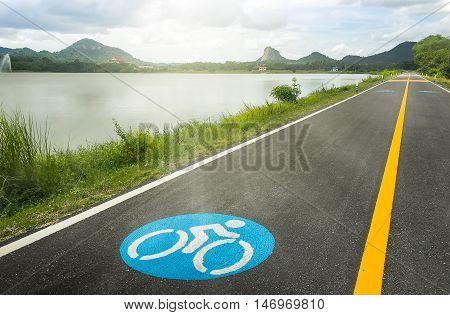 Bike lanes. Bike lane in suburb area with bike lane icon indicated. Bike lane sign on asphalt road.
