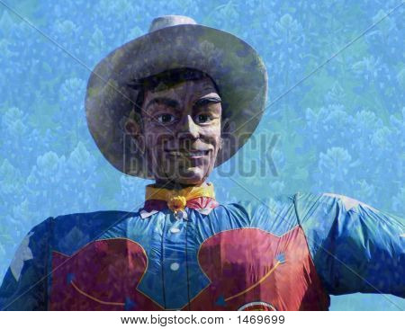 Big Texas Cowboy With Bluebonnet Background