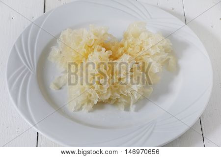 Closed up of Raw snow fungus on white plate