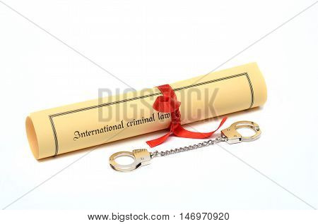 Handcuffs and International criminal law law concept isolated on the white background.