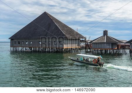 Semporna,Sabah-Sep 10,2016:Speedboats Tour with background of Dragon Inn Floating Resort at Semporna.Its a gateway for diving & snorkeling trips to the islands of Sipadan,Mabul,Mataking,Maiga & others
